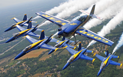 Michael Goulian in formation with the US Navy Blue Angels over Dayton, OH. 2013