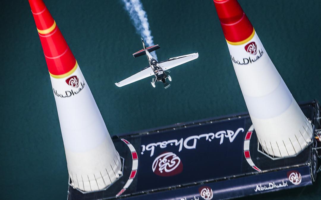 Michael piloting the Red Bull Air Race Team 99 Edge 540 through pylons in Abu Dhabi. 2015.